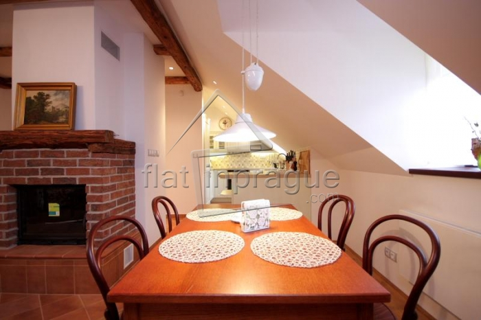 Luxury attic two bedroom apartment with a functional fireplace
